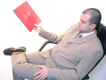 Release 2. A businessman with a document (can be a second release of a product/service or it can be cropped royalty free stock image