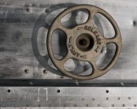 Release apply. Industrial metal background with control wheel Stock Image