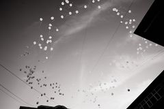 The release of white balloons into the sky. Action in memory of the victims of the accident.Release. black and white Royalty Free Stock Photography