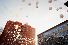 The release of white balloons into the sky. Action in memory of the victims of the accident.Release Stock Photos