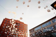The release of white balloons into the sky. Action in memory of the victims of the accident.Release Royalty Free Stock Photography