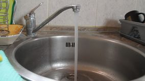 Released water from the tap in the kitchen. Water comes out faster stock footage