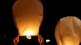 Releasing paper lantern at night stock video