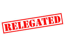 RELEGATED. Red Rubber Stamp over a white background Stock Images