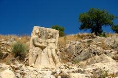 Relevo antigo: Hercules agita as mãos com rei Antiochus Imagem de Stock