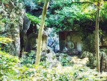 Relevos da rocha em Feilai Feng no Lingyin Temple & no x28; Templo do Soul& x27; s Retreat& x29; complexo fotografia de stock royalty free