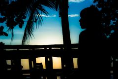 Relex before sunset. Colorfull imagine girl wommen alone think silhouette sky blue Royalty Free Stock Photos