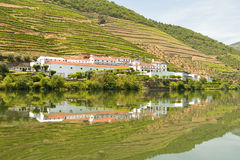 Relfection of Hotel on Water. Reflection of a hotel and outbuildings on River Diero in Portugal Stock Image