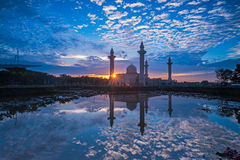 Relfection of a Mosque and Clouds at sunrise Royalty Free Stock Photo