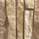 In reliëf gemaakt geel steenpatroon, achtergrond stock foto