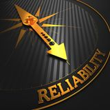 Reliability. Business Background. Reliability - Business Background. Golden Compass Needle on a Black Field Pointing to the Word Reliability. 3D Render Stock Photography