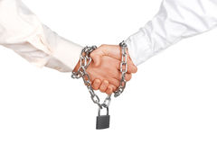 Reliable agreement. Handshake with lock and chain - reliable agreement concept royalty free stock photography