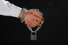 Reliable agreement. Handshake with lock and chain - reliable agreement concept stock image