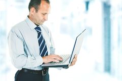Reliable laptop in the hands of a professional. Close-up of a businessman who deals on the Internet on the laptop. photo blurred background and has an empty stock photography