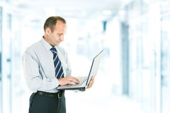 Reliable laptop in the hands of a professional. Close-up of a businessman who deals on the Internet on the laptop. photo blurred background and has an empty royalty free stock photos