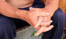 Reliable man's hands. Two men hands, sitting on the doorstep Royalty Free Stock Images