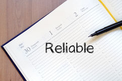 Reliable write on notebook Royalty Free Stock Image