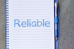 Reliable write on notebook Royalty Free Stock Photos