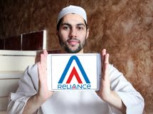 Reliance Communications logo. Logo of Reliance Communications on samsung tablet holded by arab muslim man. Reliance Communications ,RCom, is an Indian Stock Photo