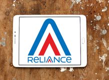 Reliance Communications logo. Logo of Reliance Communications on samsung tablet on wooden background . Reliance Communications ,RCom, is an Indian Stock Image