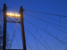 Reliance with flood lights and electrical wires, view from below royalty free stock photo