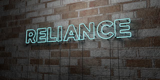 RELIANCE - Glowing Neon Sign on stonework wall - 3D rendered royalty free stock illustration. Can be used for online banner ads and direct mailers Stock Image