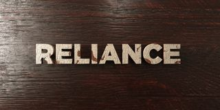 Reliance - grungy wooden headline on Maple  - 3D rendered royalty free stock image. This image can be used for an online website banner ad or a print postcard Stock Images