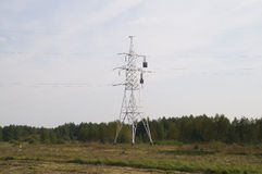Reliance power line with compensators. Pictured support power lines with a temperature compensator Stock Image