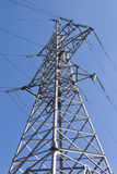 Reliance power lines. Against the blue sky Royalty Free Stock Image