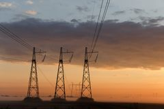 Reliance power lines against sky. Reliance power lines against cloudy evening sky Stock Images