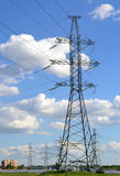 Reliance power transmission line and cumulus clouds Stock Photo