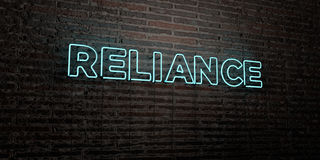 RELIANCE -Realistic Neon Sign on Brick Wall background - 3D rendered royalty free stock image. Can be used for online banner ads and direct mailers royalty free illustration