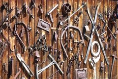 Relic Antiques on Wall Western Junk. A typical image of a western hillbilly`s decoration on the outside of their home. Relic metal junk collected from the early Royalty Free Stock Photography