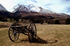 Relic dray of the past at Glen-Orchy. Old cart sits in the dry pastures of the south island of New Zealand near Lake Wakatipu Stock Photo