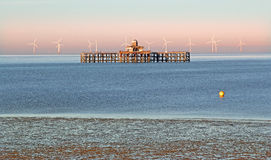 Relic pier and windfarm Royalty Free Stock Photos