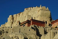 Relics of an Ancient Tibetan Castle. Relics of a famous ancient Tibetan castle named Guge in the highland of west tibet,with blue skies as background Royalty Free Stock Image