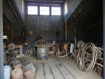 Relics of an 1880s town in South Dakota. Odds and ends displayed inside a blacksmith\'s shop at an original 1880s village in South Dakota stock images