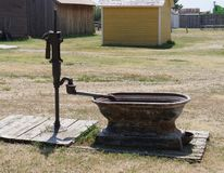 Relics of an 1880s town in South Dakota. Outdoors bathtub with a water pump in an 1880s village in South Dakota royalty free stock images