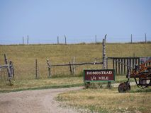 Relics of an 1880s town in South Dakota. Roadside directional sign with distance to the homestead of an 1880s town in South Dakota royalty free stock photos