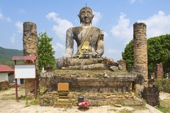 Relics of Wat Piyawat temple, Xiangkhouang province, Laos. This Buddha image is the only one in Phonsavan area, which survived US carpet bombings of Laos Stock Photo
