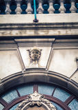 Relief above a door arch Royalty Free Stock Photography