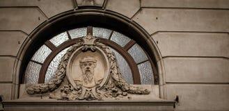 Relief above a door arch Stock Photos