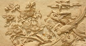 Relief Adornment picture stone material craft. Building decoration embossed with a design of sandstone stock photos