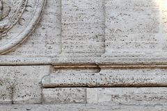 Relief of the base of two pillars Stock Photography