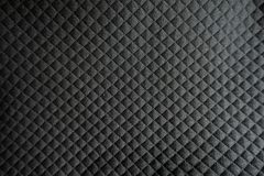 Relief checks pattern on black polyester. Fabric Royalty Free Stock Photos