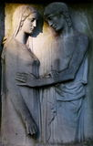 Relief of a couple. Tombstone with relief of a couple on cemetery in Rome Royalty Free Stock Images