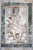 Saint George. Relief depicting Saint George, facade detail of St. Mark`s Basilica, St. Mark`s Square, Venice, Italy, UNESCO World Heritage Site Royalty Free Stock Image