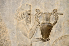Relief of the eastern stairs in Persepolis in Iran. Detail of a relief of the eastern stairs in Persepolis in Iran. UNESCO declared the ruins of Persepolis a stock image