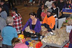 Relief efforts. Victims of the 6.4 earthquake in Christchurch, South Island, New Zealand, 22-2-2011, queue for food supplies at a relief station in New Brighton Royalty Free Stock Image