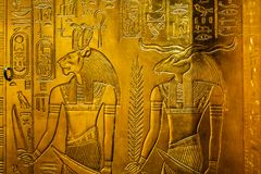Relief with egypt gods. Relief in gold with the egypt gods Sekhmet and Chnum Stock Images